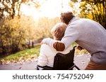 senior couple in wheelchair in... | Shutterstock . vector #754752049