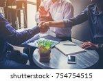 businessman handshaking process ... | Shutterstock . vector #754754515