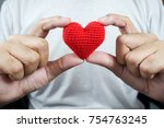 two hand holding red heart  ...   Shutterstock . vector #754763245