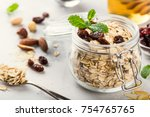 oat flakes in glass jar with... | Shutterstock . vector #754765765