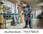 worker cutting metal with... | Shutterstock . vector #754778425