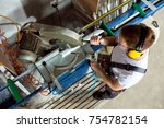 worker in the workshop cuts the ... | Shutterstock . vector #754782154