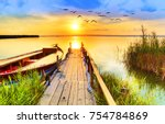 wharf of wood in the lake under ...   Shutterstock . vector #754784869