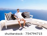 young man relaxing at a bench... | Shutterstock . vector #754794715