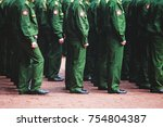 "Small photo of A formation line of russian army soldiers troops in military formation in uniform with chevron ""Russian Armed Forces"", line up during the taking the oath of allegiance ceremony, soldiers foot"