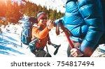 climber helping teammate climb  ... | Shutterstock . vector #754817494