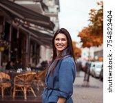 pretty brunette girl posing on... | Shutterstock . vector #754823404