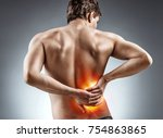 man holding his back. kidneys... | Shutterstock . vector #754863865