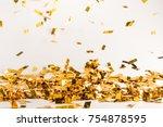 falling golden shiny confetti... | Shutterstock . vector #754878595