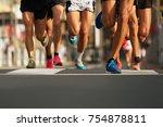 marathon runners running on... | Shutterstock . vector #754878811