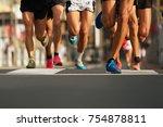 marathon runners running on... | Shutterstock . vector #754878811