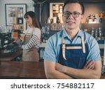 asian man barista wear blue... | Shutterstock . vector #754882117