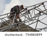 renovation of the roof of a... | Shutterstock . vector #754883899