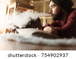 young man with a knit cap using ... | Shutterstock . vector #754902937