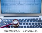 a stethoscope on a laptop....   Shutterstock . vector #754906351