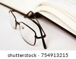 reading glasses and book with... | Shutterstock . vector #754913215