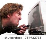 man watching tv   Shutterstock . vector #754922785