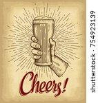 hand holding beer glass. cheers ... | Shutterstock .eps vector #754923139