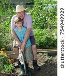 Small photo of A father and son in an allotment