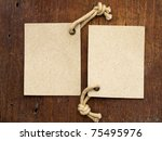 two labels on the wooden background - stock photo