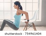 young woman exercise at home... | Shutterstock . vector #754961404