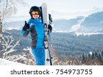 happy female skier wearing blue ... | Shutterstock . vector #754973755