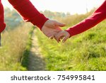 the parent holds the hand of a... | Shutterstock . vector #754995841