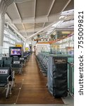 Small photo of Heathrow, Terminal 5, London, UK - September 25, 2017: Inside Terminal 5, charging your technology area. Quiet area for passengers to recharge their phones.