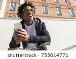 afro young man using mobile... | Shutterstock . vector #755014771