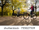 family time  riding bicycle in... | Shutterstock . vector #755027539