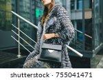 stylish woman walking in city...   Shutterstock . vector #755041471