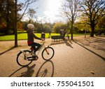 young woman riding a bike at... | Shutterstock . vector #755041501
