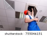 locksmith examines the fan and... | Shutterstock . vector #755046151