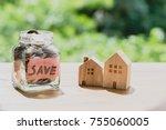 jar of coins wooden house.... | Shutterstock . vector #755060005
