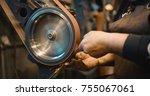 craftsman uses a belt sander in ... | Shutterstock . vector #755067061