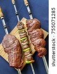 brazilian beef swords with blue ... | Shutterstock . vector #755071285