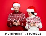 Small photo of Curious secretive obsessed possessive controlling drama queen spies on lover`s smartphone, x mas costumes, head wear, isolated on pure background