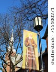 Small photo of Detroit, MI/USA: Nov 14, 2017: Banner on lamp post honors Blessed Solanus Casey outside St Bonaventure Monastery during week of his ceremonial elevation to Blessed, one step before Catholic sainthood.