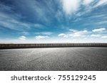 empty asphalt road and snow... | Shutterstock . vector #755129245