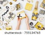 hands holding beautiful gift... | Shutterstock . vector #755134765