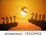 silhouette of young man jumping ... | Shutterstock . vector #755139925