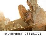 couple using laptop computer | Shutterstock . vector #755151721