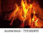 a fire burns in a fireplace ... | Shutterstock . vector #755182855