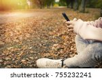 mobile phone hands in the fall... | Shutterstock . vector #755232241