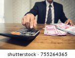 businessman pressing calculator ... | Shutterstock . vector #755264365