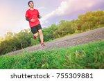 man running sprinting on road.... | Shutterstock . vector #755309881