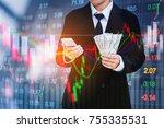 businessman holding money us... | Shutterstock . vector #755335531