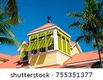 mansard with open yellow window ... | Shutterstock . vector #755351377