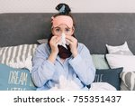 young sick woman in bed with... | Shutterstock . vector #755351437