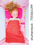 doll laying in the baby cot.... | Shutterstock . vector #755361199